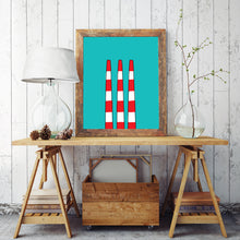 The Halifax/Dartmouth smokestack illustration in a frame on a table.