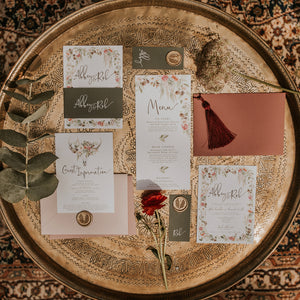 Bespoke wedding stationery with custom floral wreaths and cow skull decor