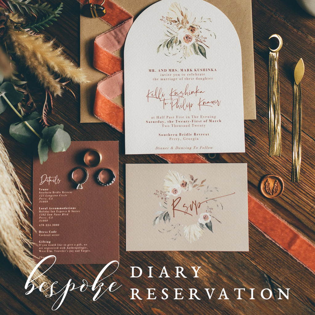 Bespoke wedding stationery with arch shape invite and custom floral wreaths