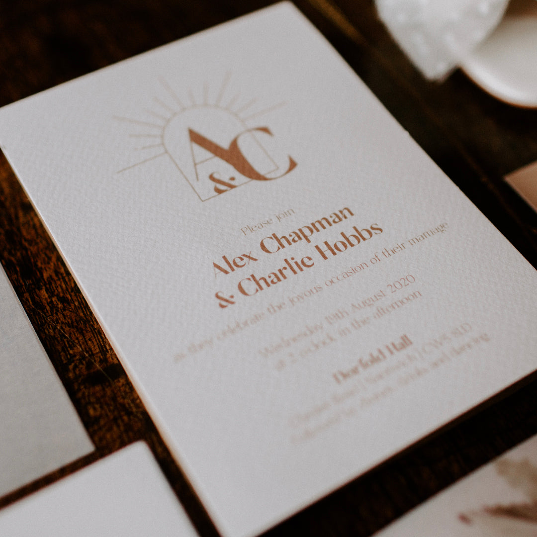 The chic and modern 'Ethereal Love' invitation with sunburst arch monogram.