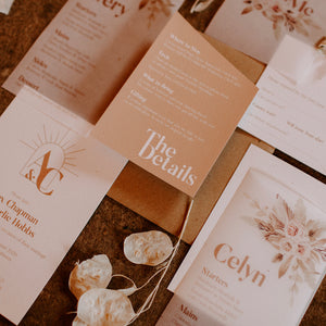 The chic and modern 'Ethereal Love' invitation suite with sunburst arch monogram and vellum.