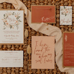 The Nola suite laid out showing invites, information card and RSVP