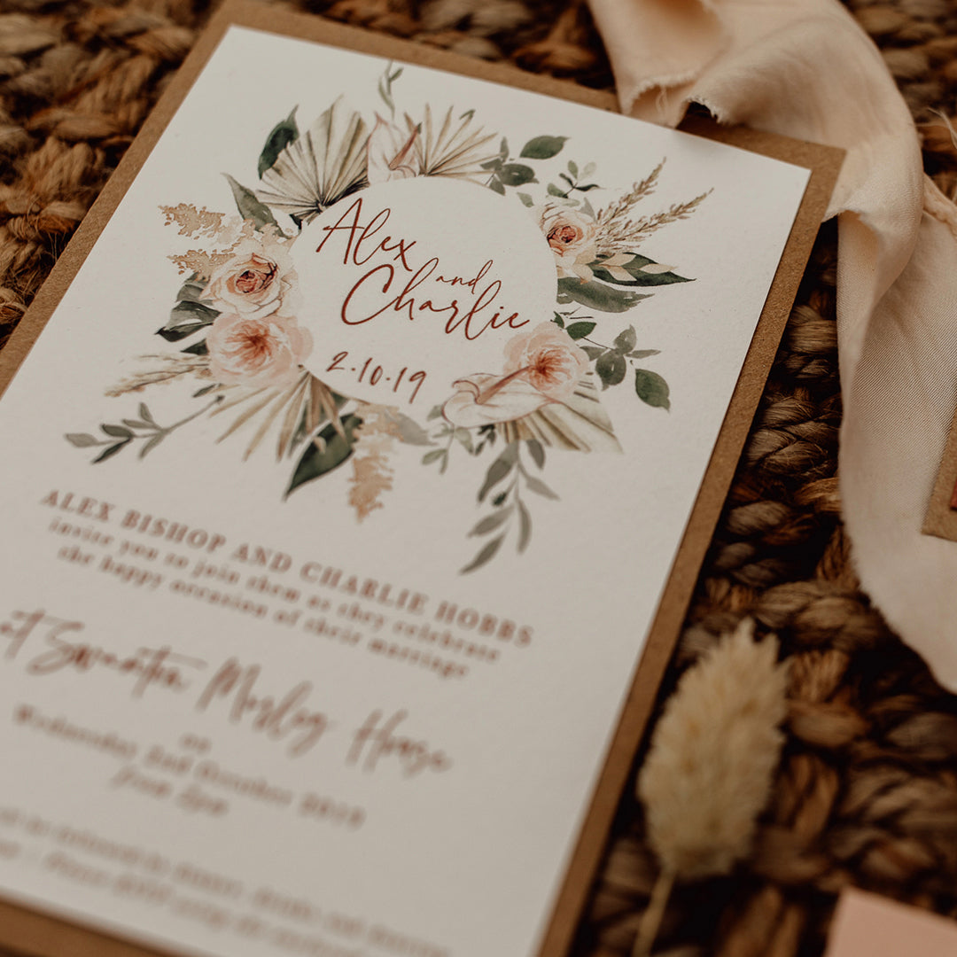 The Nola suite laid out showing the invitation detail of the floral wreath