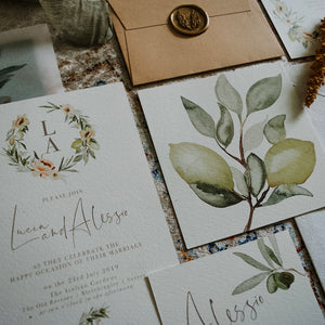Rustic wedding stationery with watercolour olive and lemon wreaths and modern calligraphy fonts.