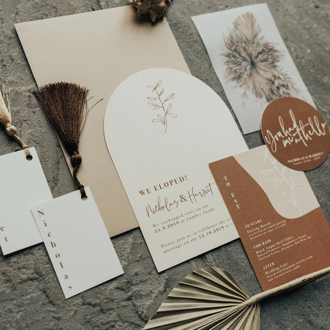 Curved wedding invites with natural colours. Details and RSVP card in tan and cream tones.
