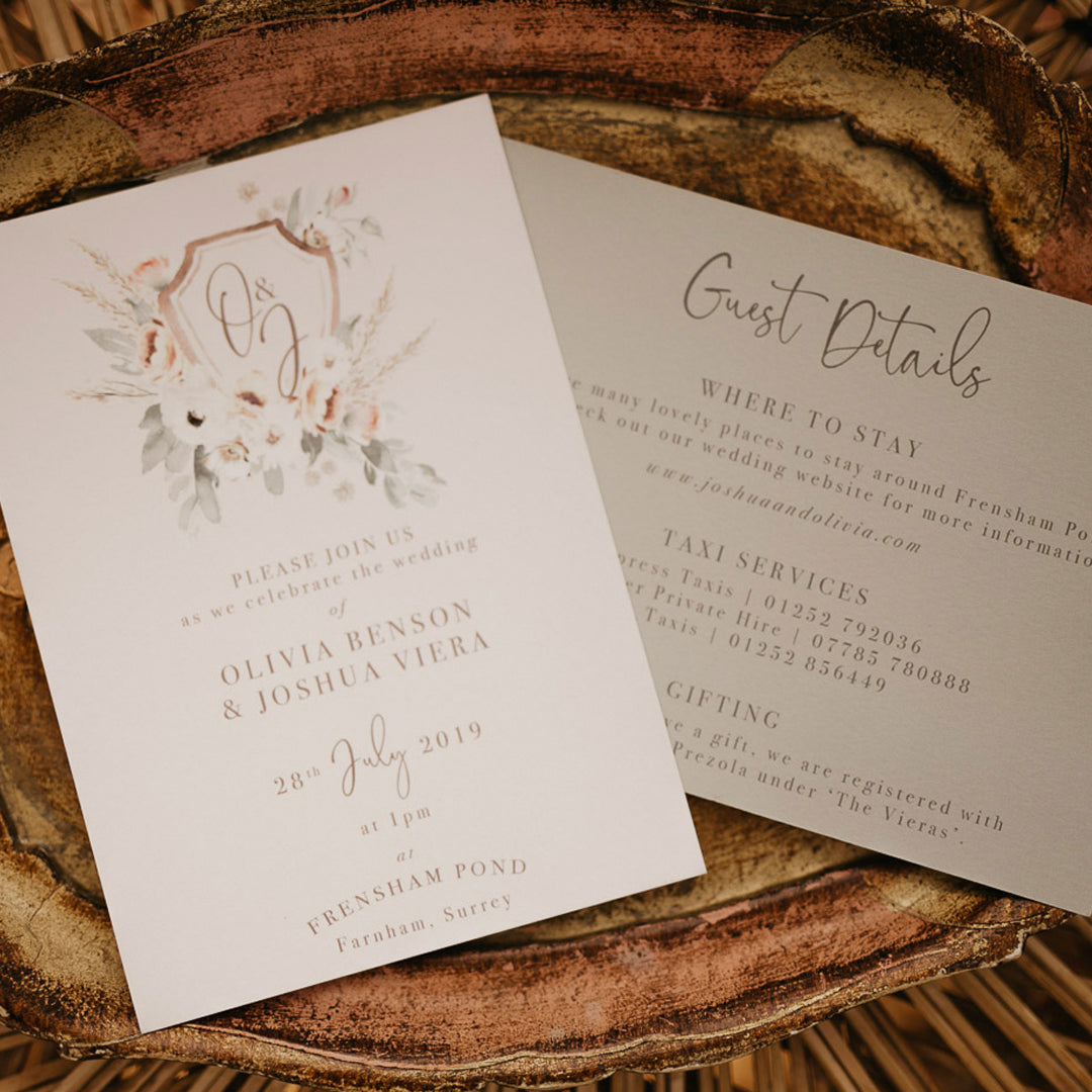 Floral wreath wedding invitations with green and pink tones. Watercolour wedding invitations with modern fonts.