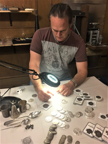 Jewelry designer Andrew Vandekop reviewing silver items for the Backyard Silversmiths Trade-In Your Silver Program.