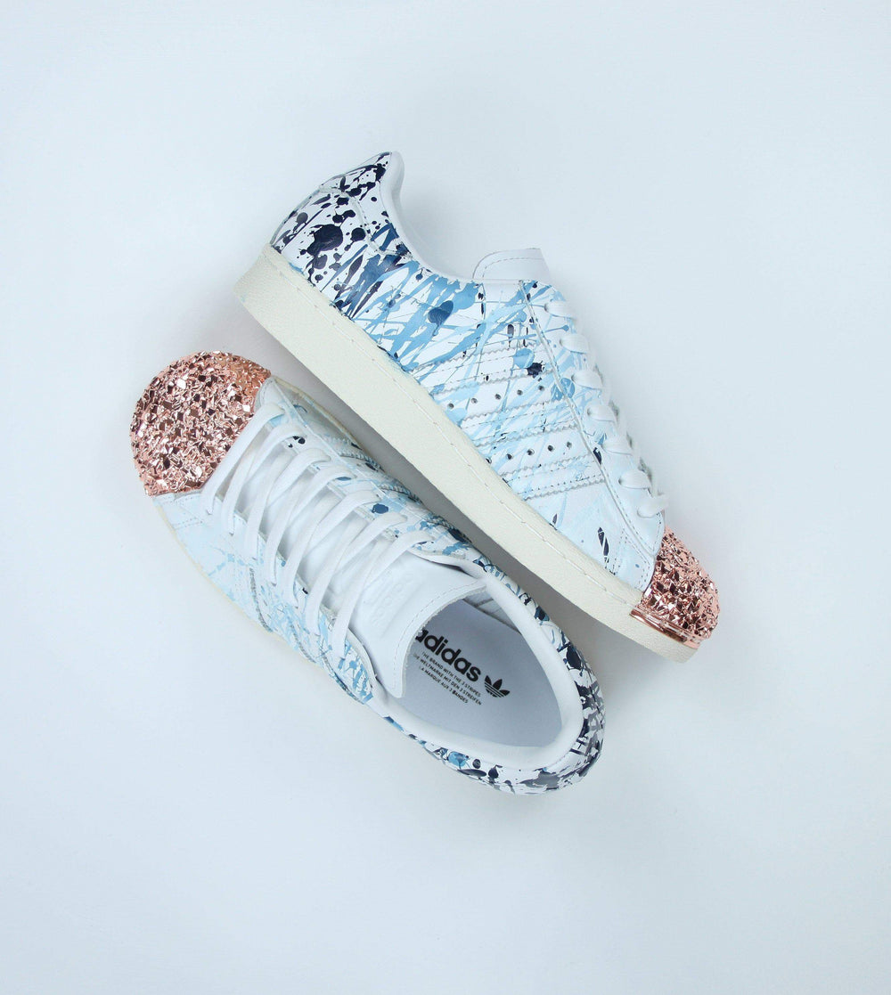 quality design 1fb57 49850 TheShoeCosmetics - Blue Splatter Adidas Superstar Rose Gold Shell Toe  Custom Shoes