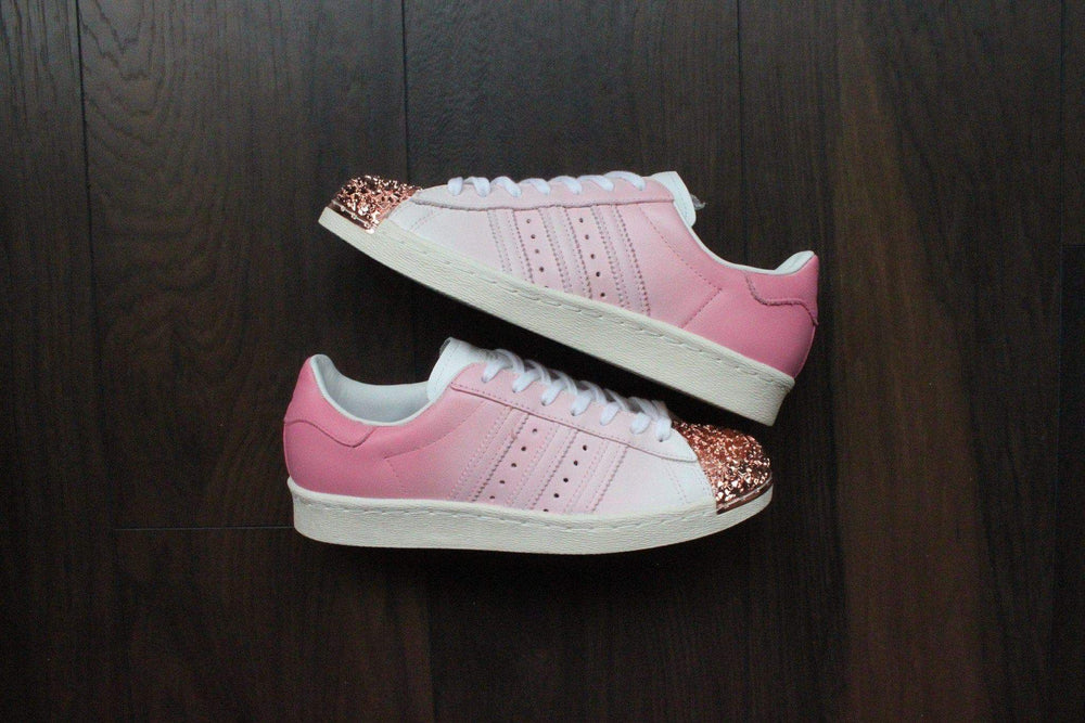 9ce75bc4ac80 TheShoeCosmetics - Pink Adidas Superstar Rose Gold Shell Toe Custom  Sneakers - Ombre Design