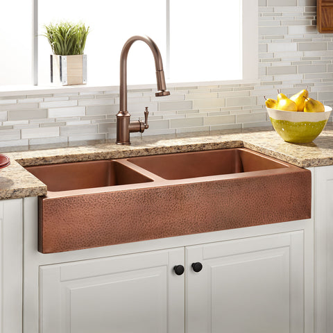 copper retrofit sink in a farmhouse kitchen