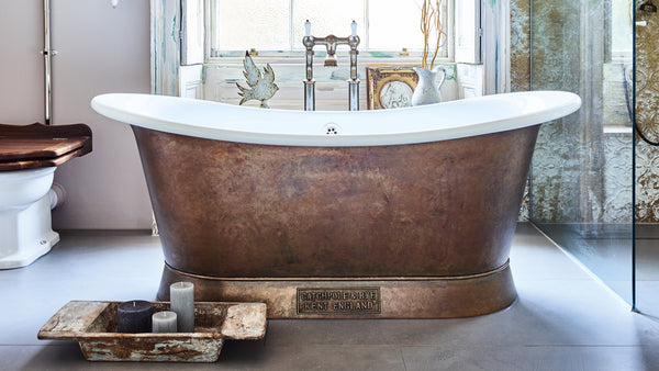 copper bateau bathtub in a bathroom