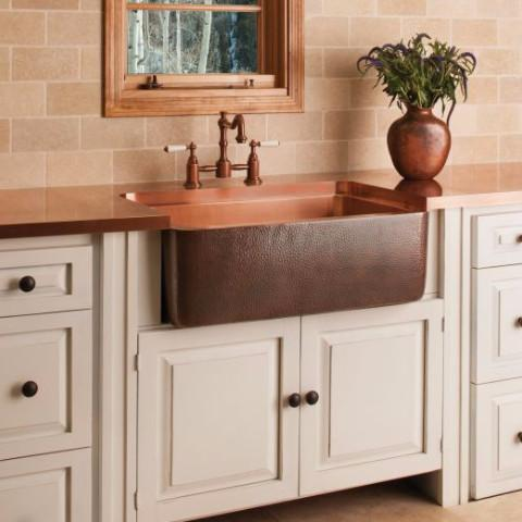 drop-in copper sink in a kitchen counter country style