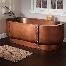 copper tub with rivets in a custom bathroom