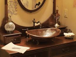 round copper sinks in a bathroom