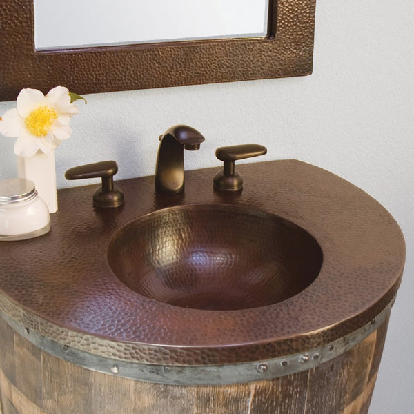 designing a bathroom with a copper sinks