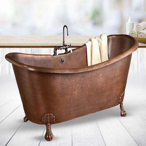 picture of free standing copper in antique style but in a rustic bathroom
