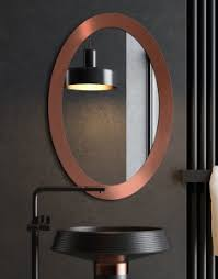 coper oval mirrors hanged on the living room wall