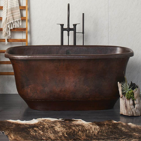 hammered copper rustic tub in a bathroom