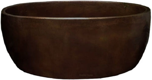 country hand fabricated copper tub