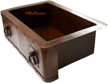 side view of a classic apron copper sink for a kitchen