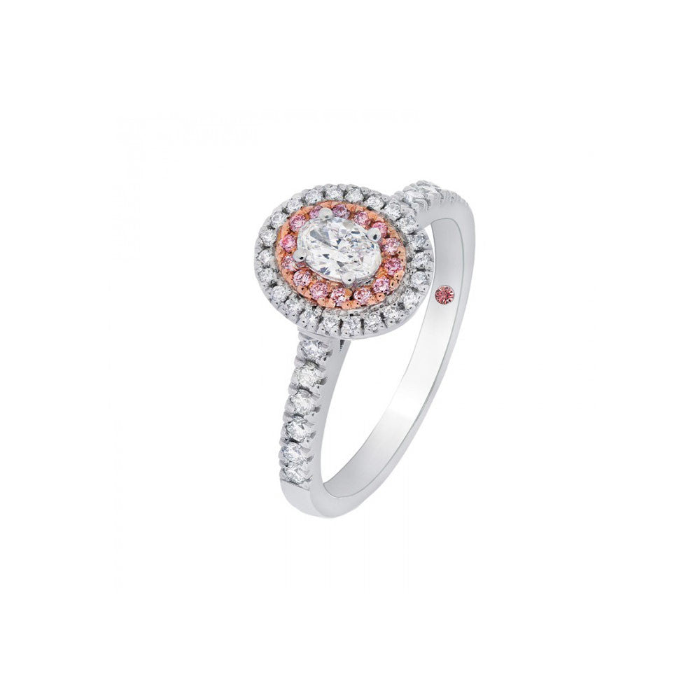 Pink and white oval cut diamond engagement ring