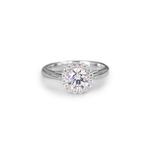 Round brilliant cut halo engagement ring