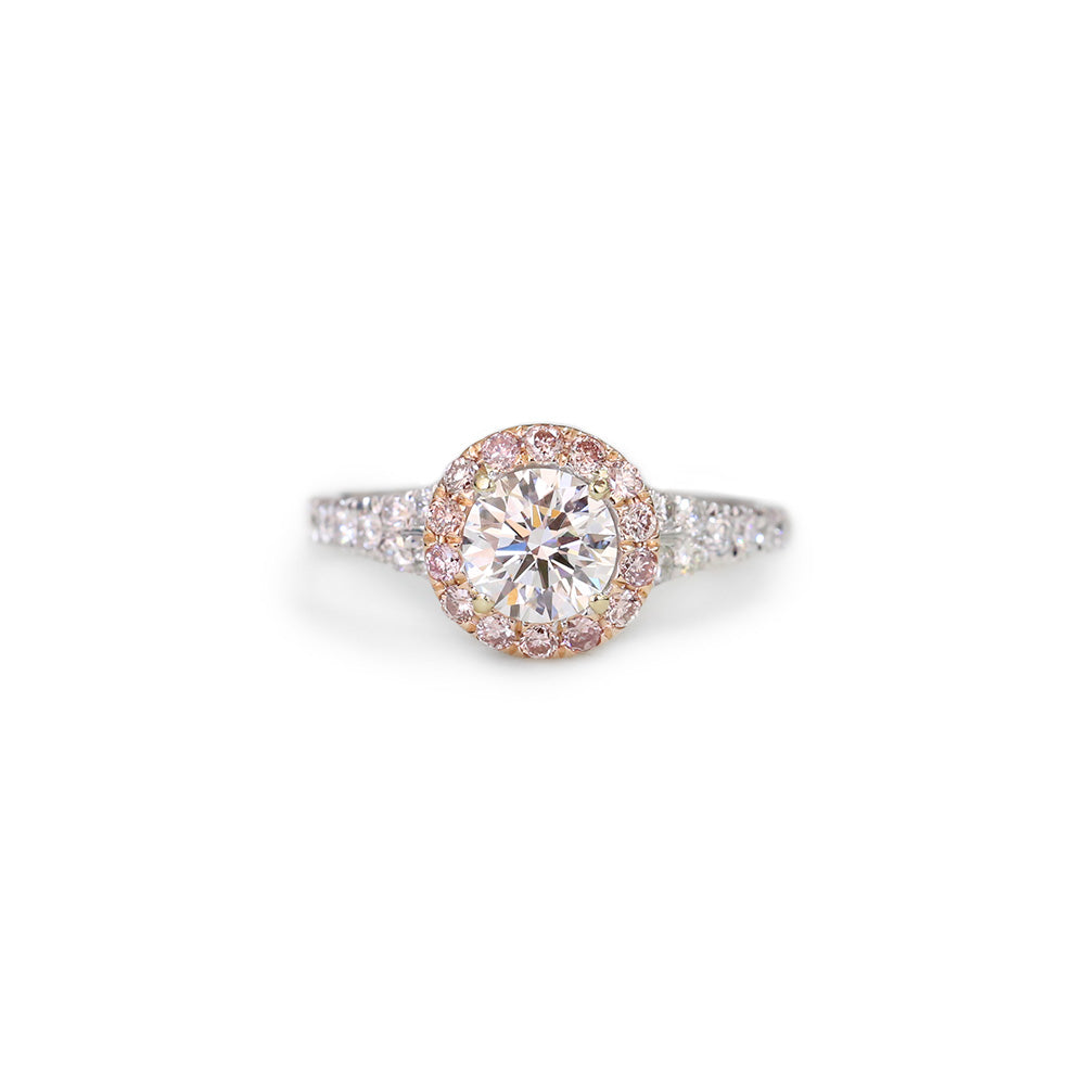 Pink and white diamond halo engagement ring