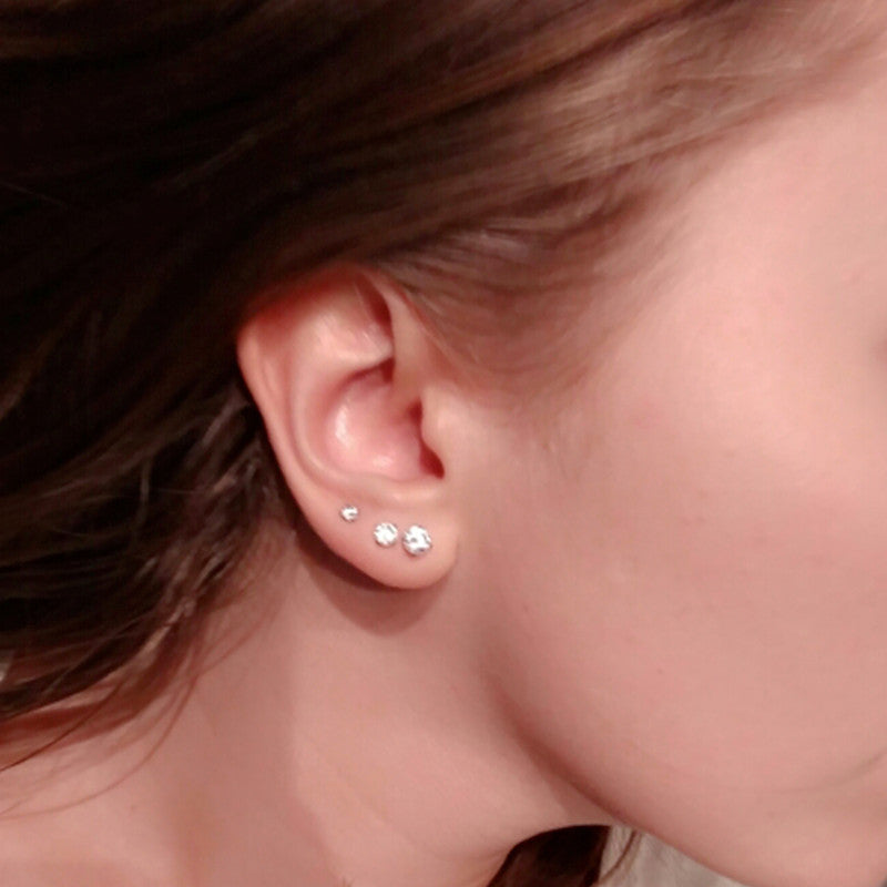 Four Prong Set Clear Stud Earrings - Order Today!