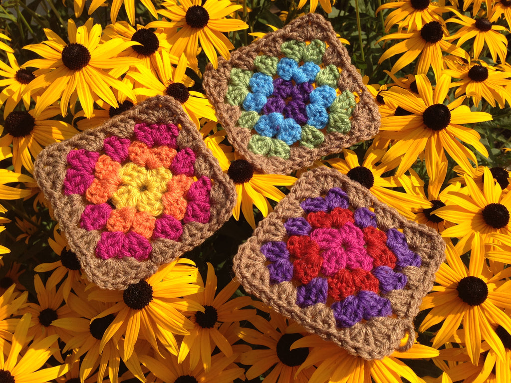 crocheted granny squares on top of black eyed susan flowers