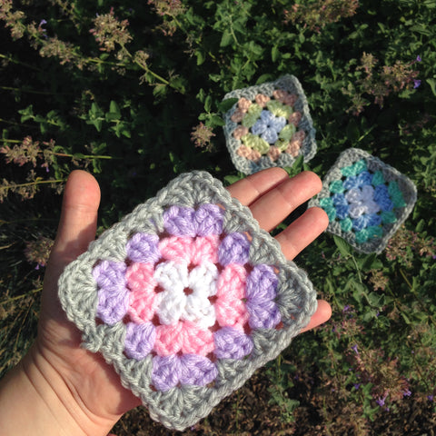 pastel granny squares on top of lavender flowers