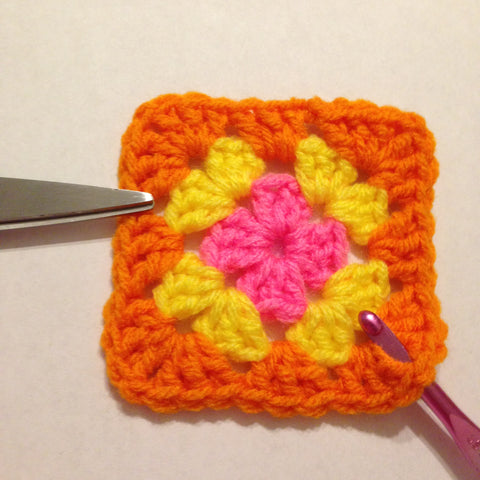 row 3 completed of a granny square