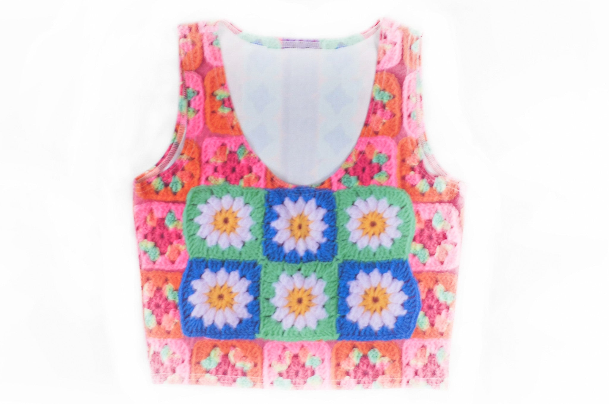 Snapdragon Brand Clothing Granny Square Crochet Print neon crop top cropped sleeveless shirt in style Playa Daisy features a vintage psychedelic boho feel and a rainbow of colors. Made of comfortable spandex. Daisies