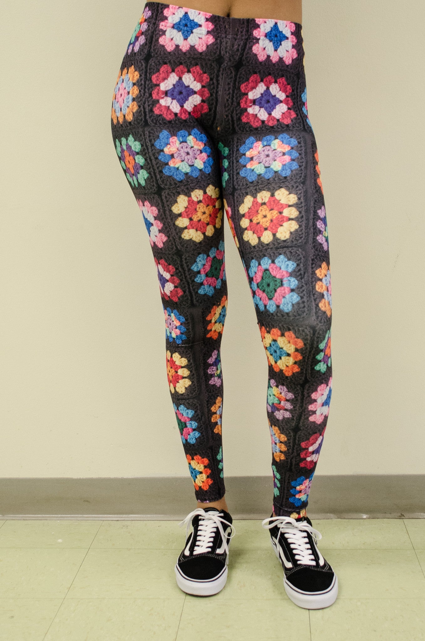 Snapdragon Brand Clothing Granny Square Crochet Print black leggings in style Kaleidoscope features a 1960s vintage boho feel and a rainbow of colors. Made of comfortable spandex.