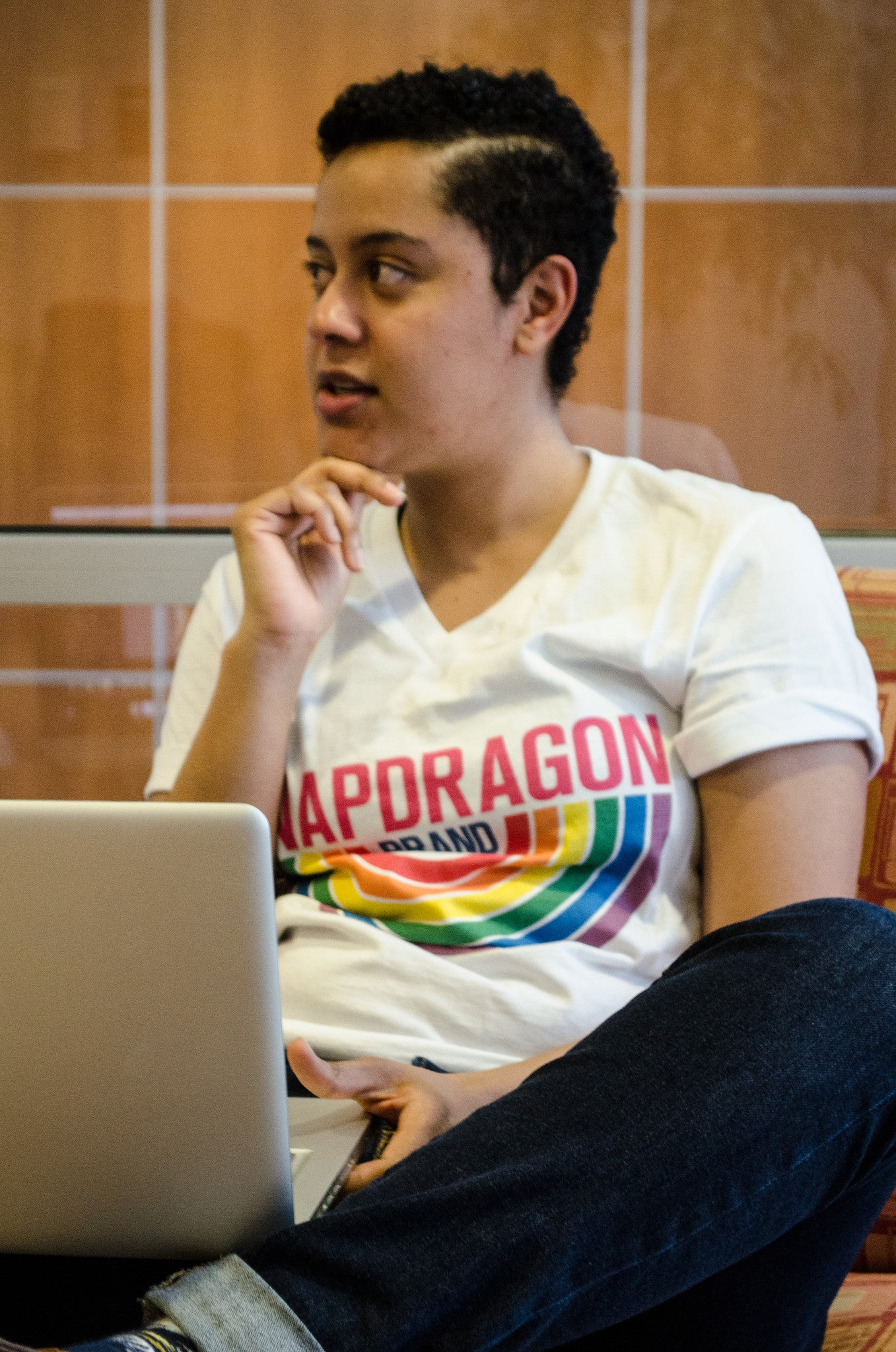 Snapdragon Brand Clothing Granny Square Crochet Print unisex rainbow v-neck tee t-shirt in style logo features a vintage psychedelic boho feel and a rainbow of colors. Made of comfortable cotton. lgbt lgbtq lgbtqi