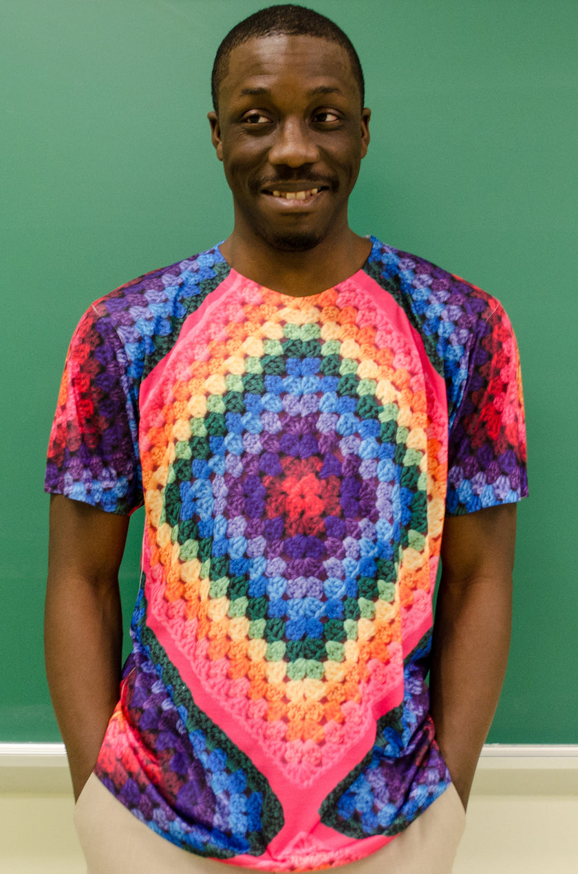Snapdragon Brand Clothing Granny Square Crochet Print rainbow tie-dye t-shirt in style Rainbow Soul features a vintage psychedelic hippie boho feel and a rainbow of colors. Made of comfortable polyester.