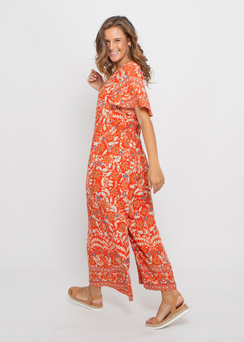 HOLIDAY JUMPSUIT - RED FLORAL PRINT
