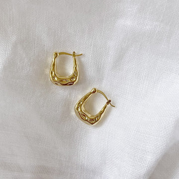 The Hammered Horse Shoe Hoop earring