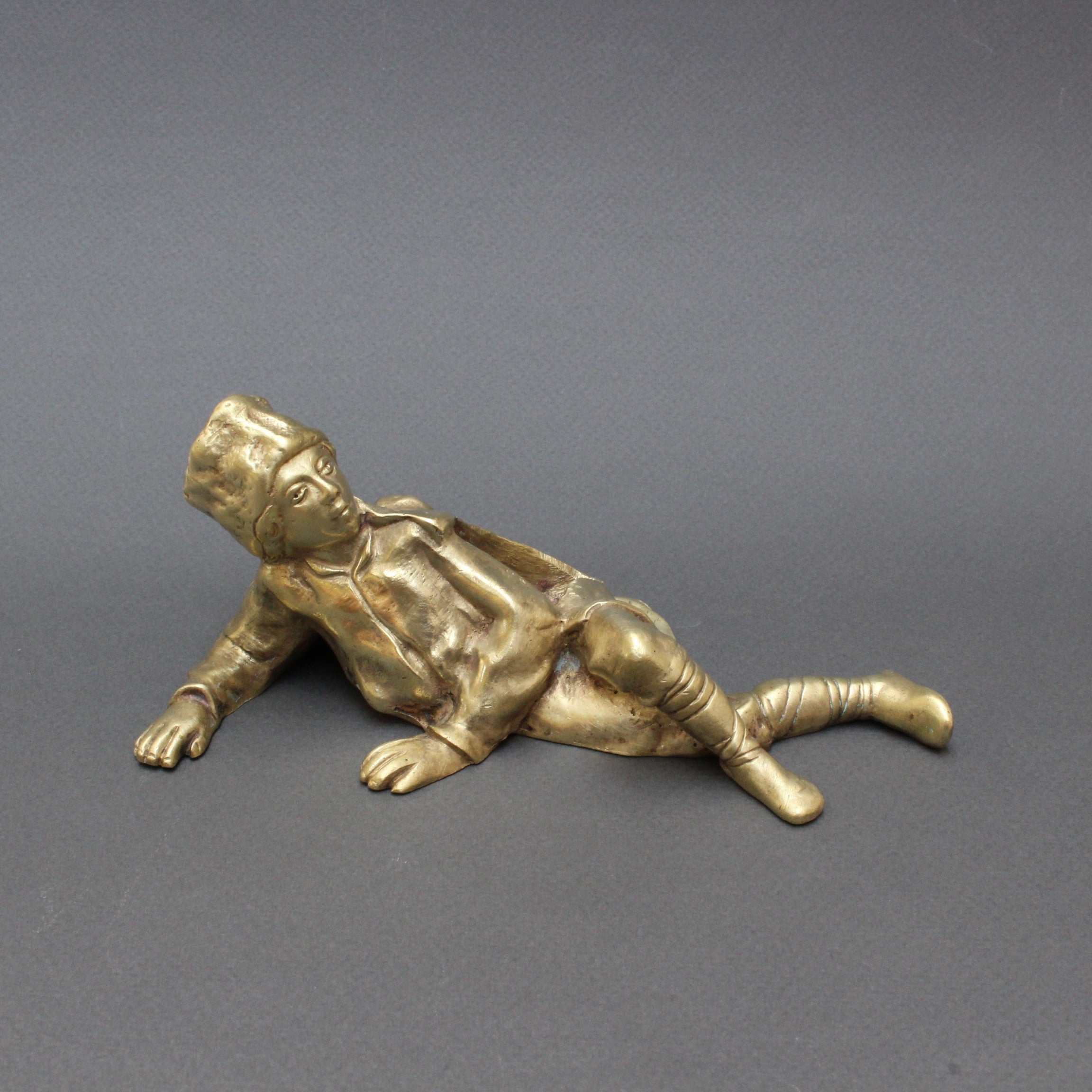 Italian Vintage Brass Desk Paperweight of Reclining Boy Soldier