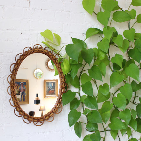 Italian Oval Shaped Rattan and Bamboo Wall Mirror (circa 1960s)
