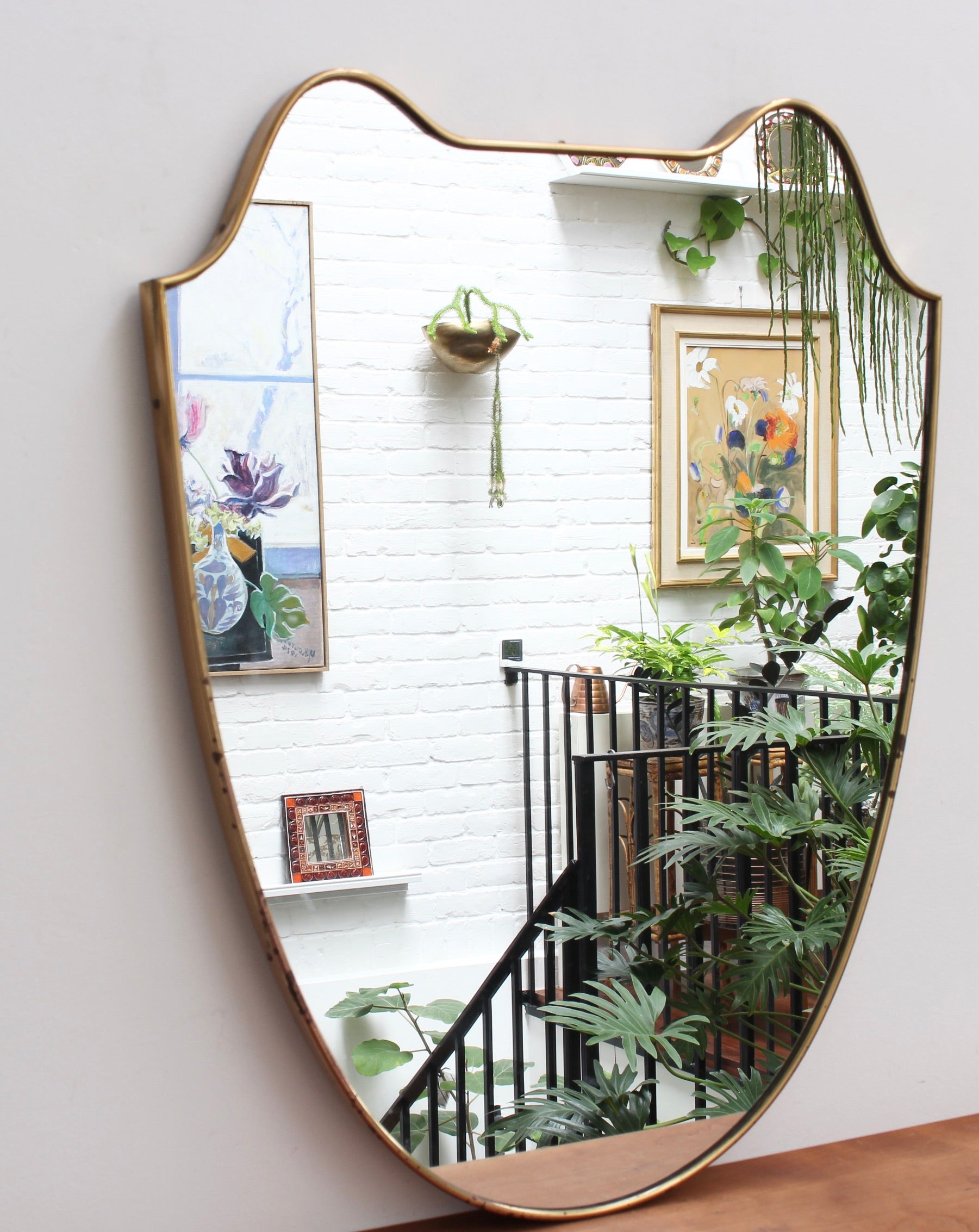 Mid-Century Eared Crest-Shaped Italian Wall Mirror with Brass Frame (circa 1950s)