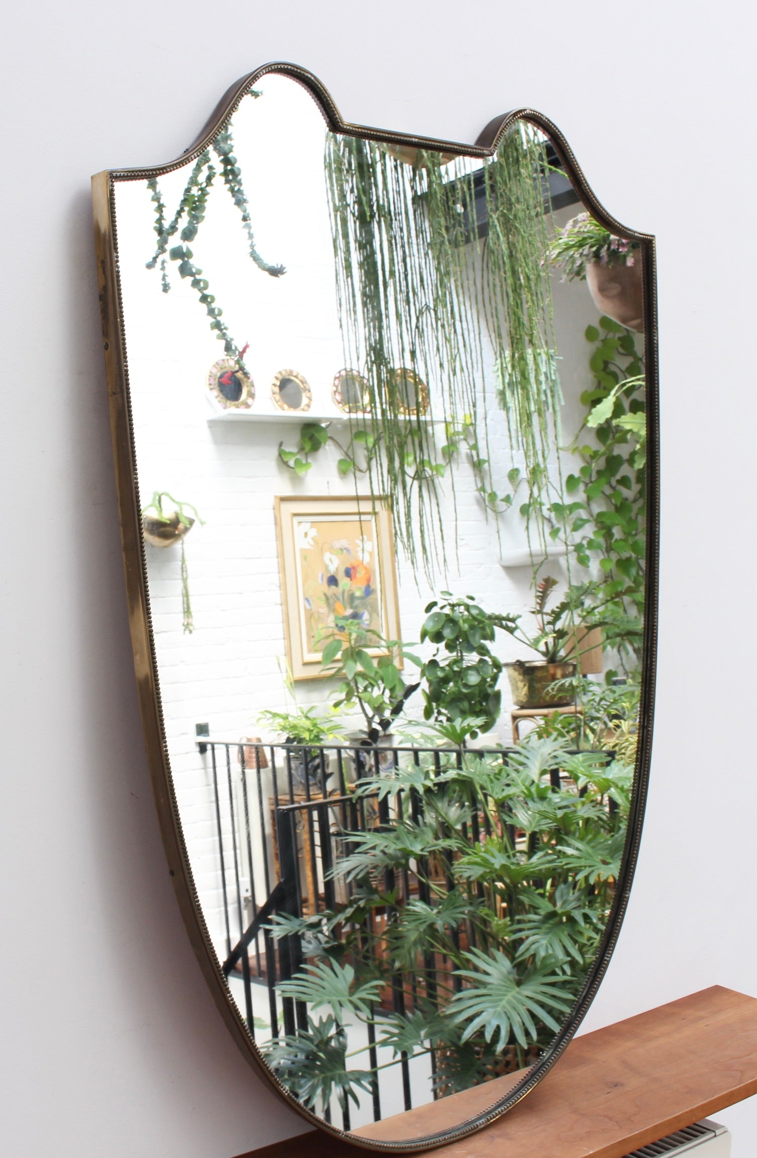 Mid-Century Italian Crest-Shaped Wall Mirror with Distinctive Beading (circa 1950s)