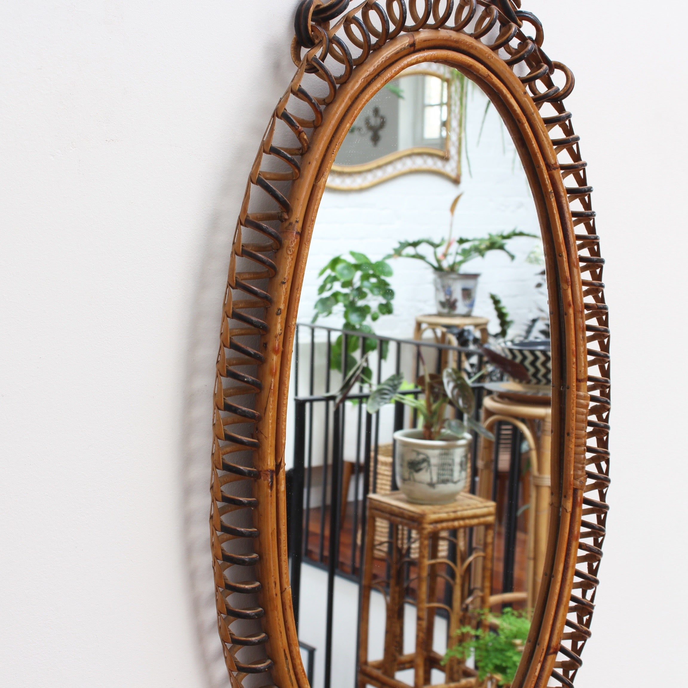 Italian Oval-Shaped Rattan Wall Mirror with Hanging Chain (circa 1960s)