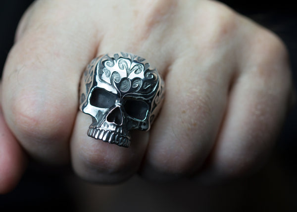 Carved sterling silver skull rings.