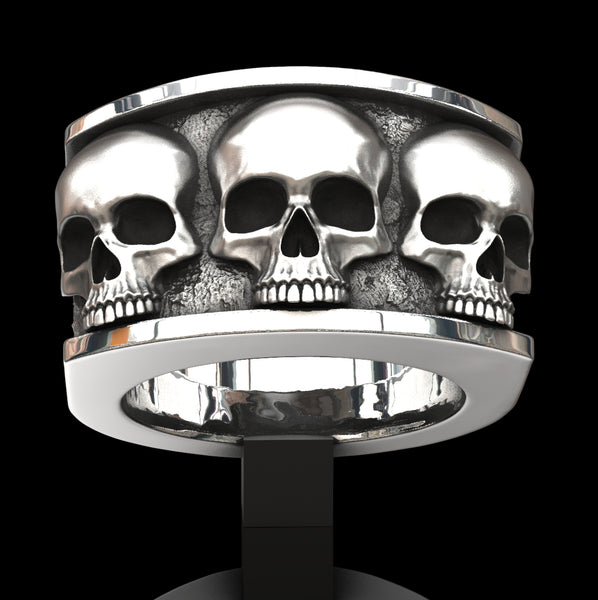 Three skull ring