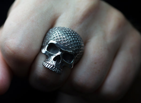 Sterling silver chain mail skull rings.