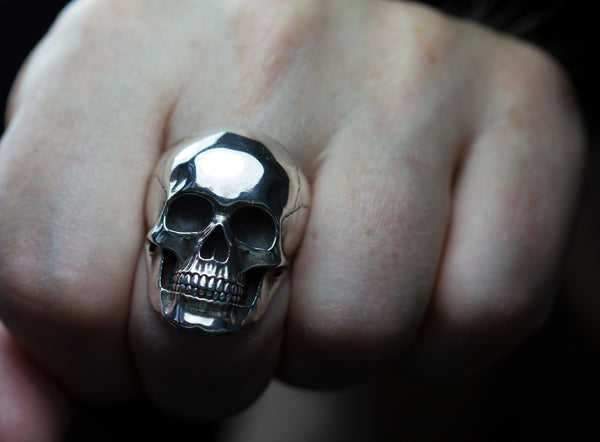 Anatomical sterling silver skull ring.