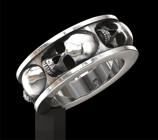 Five skull band ring
