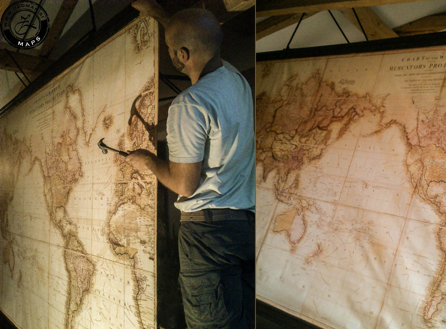 Making of largest wall cotton canvas maps, antique wooden trims.