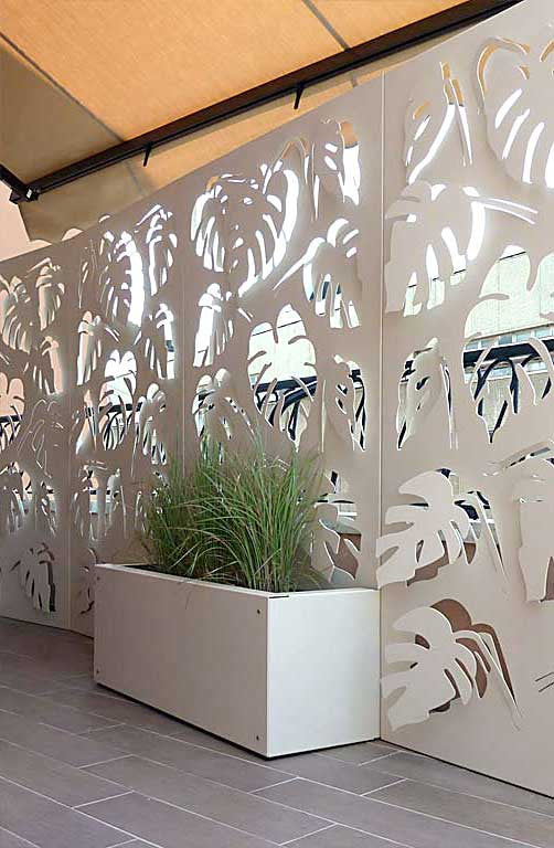 Monstera deliciosa laser cut panels with aluminum planters fixed to the balustrade.