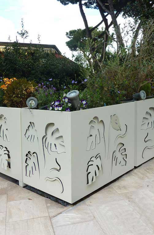 balustrade planters decorated on both sides with laser cut aluminum monstera leaves
